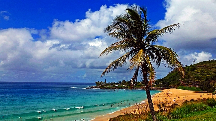 Waimea Bay Beach in the summer. But is it the best time to travel to Hawaii?