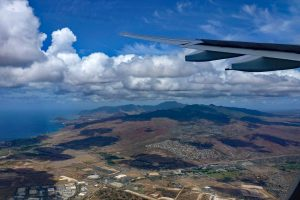 Flying on an airline offering cheap flights to Hawaii.